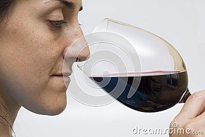 Woman tasting wine.