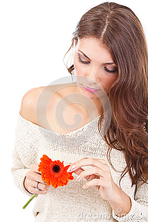 Woman tearing flower petal