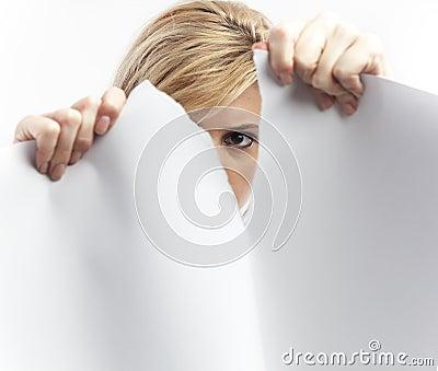 Woman tearing paper sheet