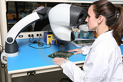 Woman Technician with Microscope