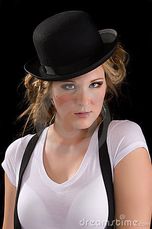Woman in tee shirt and black hat