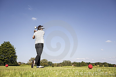 Woman teeing off.