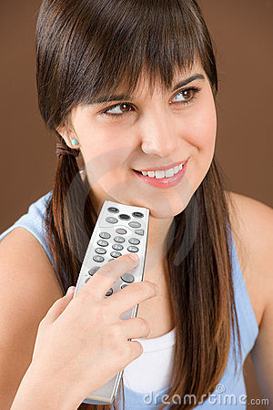 Woman teenager hold remote control