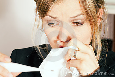 Woman with temperature and flu