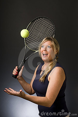 Woman tennis player happy serving ball