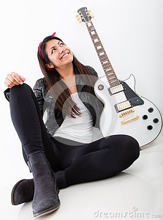 Woman thinking of being a rock star