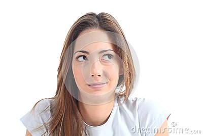 Woman thinking with her eyes looking at side