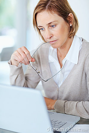 Woman Thinking While Working At Her Desk Royalty Free Stock Images - Image: 14974409