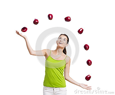 Woman throwing apples