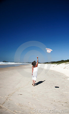 Woman throwing hat in air