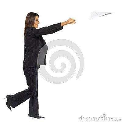 Woman throwing paper plane