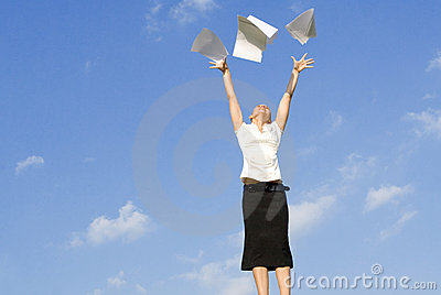 Woman throwing papers in air