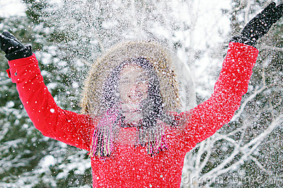 Woman throwing snow