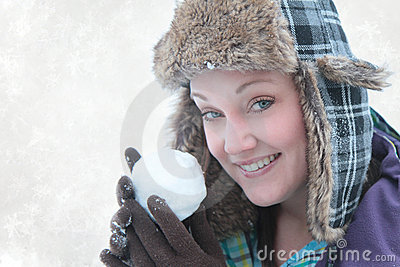 Woman throwing snow ball
