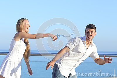 Woman throwing water to her boyfriend