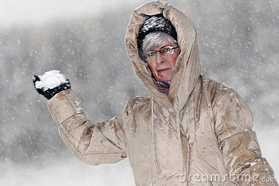 Woman throws snowball
