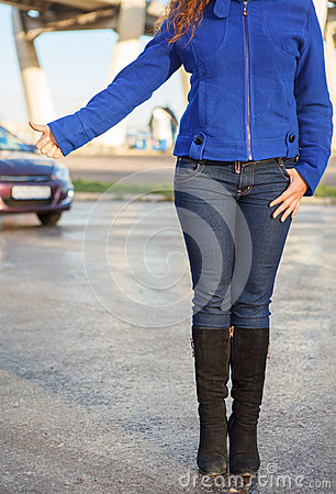 Woman with thumb lift on roadside