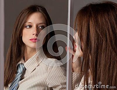 Woman in Tie Looking In Mirror