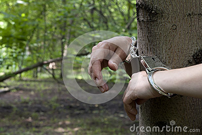 Woman tied to a tree in the forest