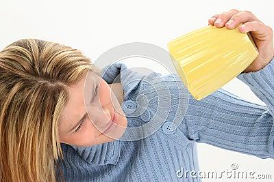 Woman tipping up beaker