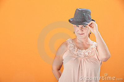 Woman Tips Her Hat