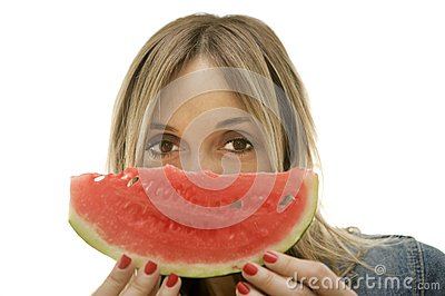 Woman about to enjoy slice of watermelon