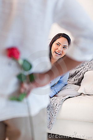 Woman about to get a flower by her boyfriend