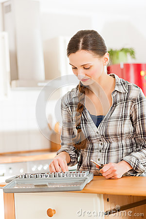 Woman with toolbox and screwdriver
