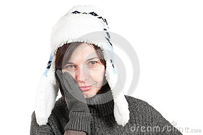 Woman with a toothache, wearing winter hat and glo
