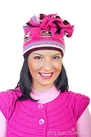 Woman with toothy smile in pink knitted cap