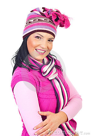 Woman with toothy smile in pink knitted clothes