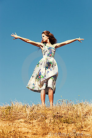 Woman on top of the hill, blue sky , summer day