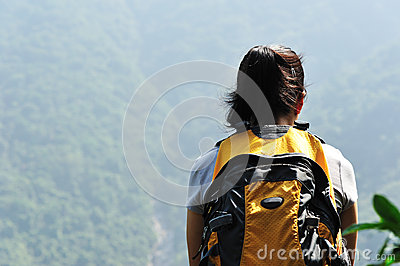 Woman top of mountain