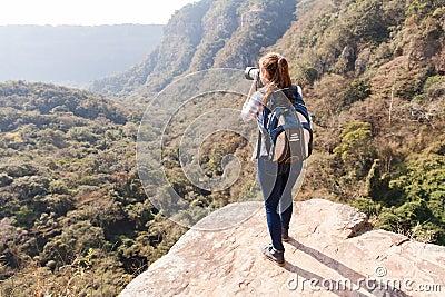 Woman top mountain