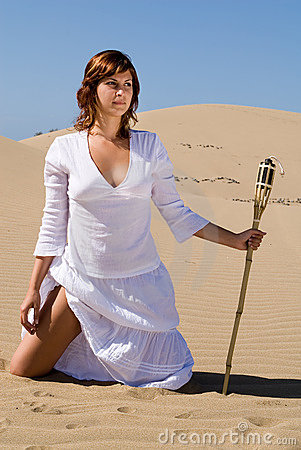 Woman With Torch In The Sand Royalty Free Stock Photography - Image: 4739837