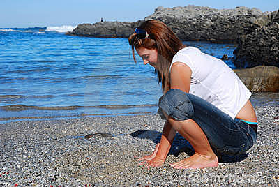 Woman touching beach sand