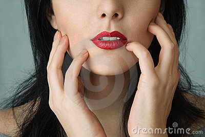 Woman touching cheek