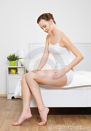 Woman touching her smooth health hip