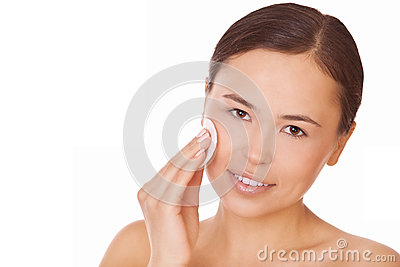 Woman touching pure cotton pad face