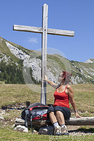 Woman touching wooden cross