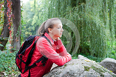 Woman tourist relaxing on nature