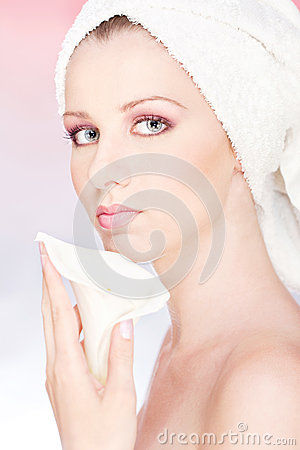 Woman with towel gently holding flower