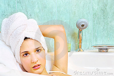 Woman with towel on head in the bathtub