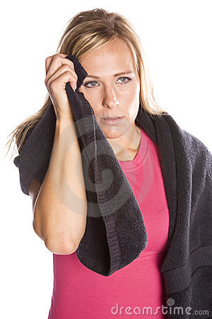 Woman with towel wiping face