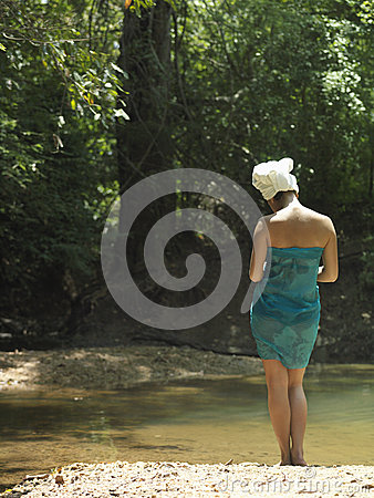 Woman With Towel Wrapped on Head And Body By Lake