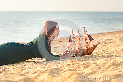 Woman with a toy ship