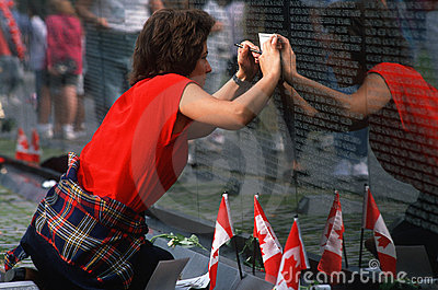 Woman tracing name at Vietnam Wall Editorial Photography
