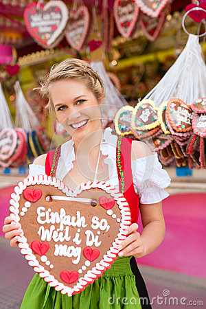 Woman in traditional Bavarian clothes or dirndl on festival