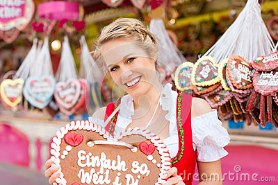 Woman in traditional Bavarian  dirndl on festival