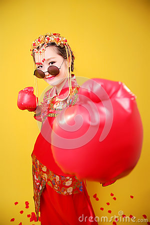Woman in traditional Chinese costume and boxing gloves Stock Photo